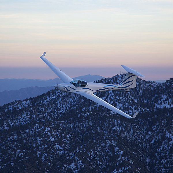 Glider over mountains